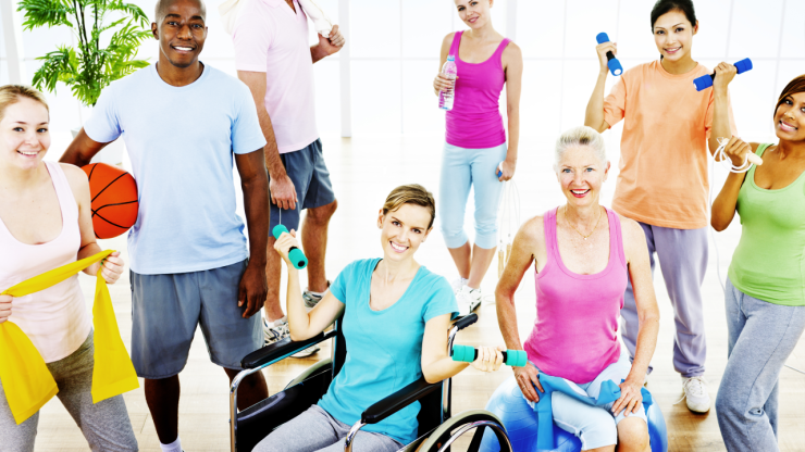 Diverse group of people with exercise equipment.